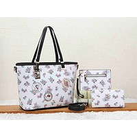 Coach is selling a three-piece shopping bag with women's print