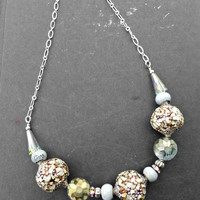 Crystal, ceramic and metal chunky beaded and silver necklace.
