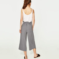 CROPPED TROUSERS WITH SIDE TIE