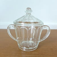 Simple everyday pressed glass sugar bowl with lid and arched panel sides