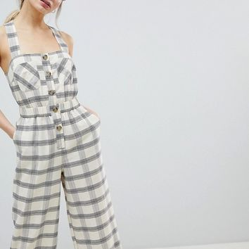ASOS DESIGN Jumpsuit With Elasticated Waist And Button Detail In Check at asos.com