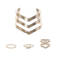 Set of Gold Rings and Arrow Cuff