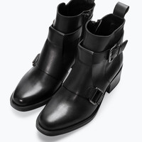 Leather mid heeled buckled bootie