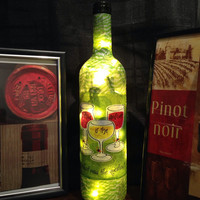 Wine is the answer. What was the question? Wine bottle lamp, bottle light, accent lamp, night light