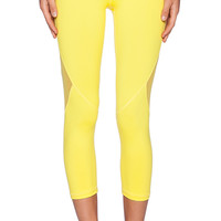 ALALA Crop Tight Letting in Yellow