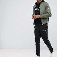 Nicce London TALL Skinny Joggers In Black at asos.com