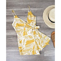 Dripping in Finesse Leaf Print Wrap Romper in Yellow
