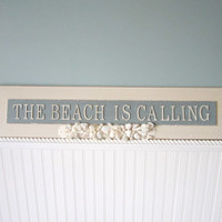 Beach Decor Sign - The Beach Is Calling - Nautical Sign w Shells, Coral, and Sand Dollars