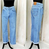 Vintage Levis orange tab jeans 31 X 29 / size 7 / 8 / LEVI'S  high waisted jeans / straight leg / medium wash
