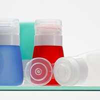 Travel Size Bottles Four 2 Oz - High Quality Refillable Leak Proof Portable Silicone Containers in a TSA Approved Clear Toiletry Bag - Good for Airplane, Gym, Rv with Shampoo, Conditioner, Lotion, Food Items: Smoothies, Salad Dressing, Milk