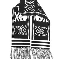 Protect ya' neck in the cozy warmth of doom with this skull and crossbone scarf from Sourpuss! This acrylic knit scarf features a horizontal black and white repeating skull pattern, striped detail and tasseled ends.