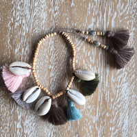 Five Tassel Shell Bracelet -  Wooden Beaded with 5 Cowrie Shells and 7 Cotton Tassels.