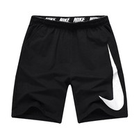 Nike men's trousers summer new knitted big logo baggy running pants five minute pants shorts