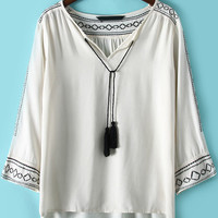 White Tassel V- Neckline Embroidered Dip Hem Blouse