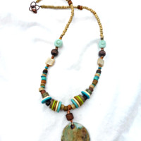 Ceramic, metal and glass necklace. Bohemian jewelry.