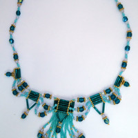Beaded necklace in shades of teal,sea foam green and dark green.