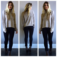 A Beige Pullover Sweater