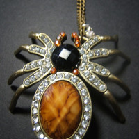 Crystal bling spider tarantula rhinestone faux gem necklace pendant on 24 inch aged brass oval link chain
