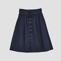 SKIRT WITH METAL GROMMETS DETAILS