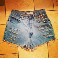 Blue wash high-waisted denim shorts with studs