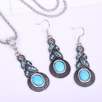 Turquoise Colored Rhinestone Necklace And Earrings