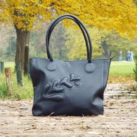 Blue leather tote bag. Dark blue leather purse with embossed decor.