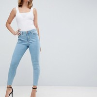 ASOS DESIGN Petite Ridley high waist skinny jeans in ariel bright light stone wash at asos.com
