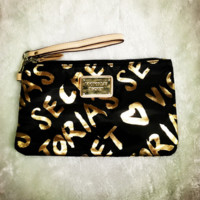 Victoria's secret handbags makeup bag to receive bag black golden letters