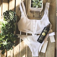 Knotted and buckled swimming suit