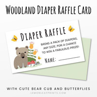 Woodland baby shower diaper raffle ticket with cute bear cub next to a mossy rock