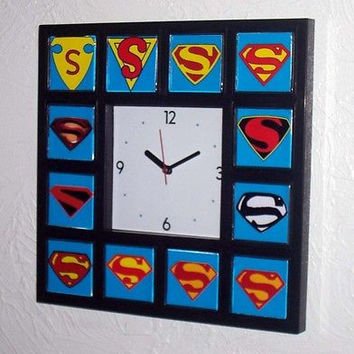 History of Superman S Clock with 12 classic chest emblems s