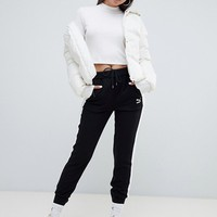 Puma Down Filled Cream Jacket With Hood at asos.com
