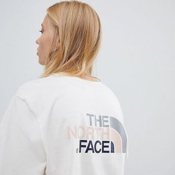 The North Face Exclusive to ASOS Long Sleeve Easy T-Shirt in Vintage White at asos.com