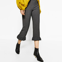 FRILLED TROUSERS DETAILS