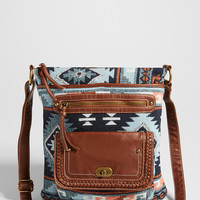 faux leather and fabric crossbody bag in blue ethnic print