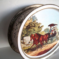 Vintage Very Large Oval Sunshine Biscuit Tin With 2  Currier Ives Scenes Distressed Rusty Measures 14.5 Inches Wide X 3 And 3/4 Inches Tall