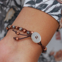 """Boho crochet bracelet with brown and blue glass beads and a vintage button clasp with tassel and matching beads 7"""""""