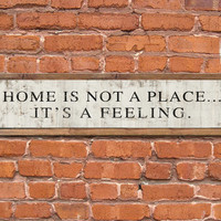 "Home is not a place it's a feeling typography wooden sign.  36""x9""x2"" Handmade."