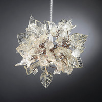 Chandelier lighting. Crystal clear flowers and leaves.