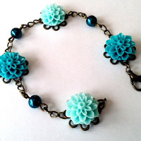 Gorgeous teal and aquamarine resin flower and Swarovski pearl bracelet by Peachykeenthings