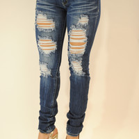 Distressed medium wash jeans