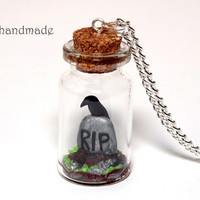 RIP tombstone with raven in a glass jar necklace