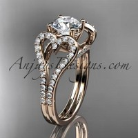 """14kt rose gold heart engagement ring, wedding ring  with a """"Forever One"""" Moissanite center stone ADER395"""