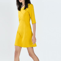Fitted dress with crossover neckline