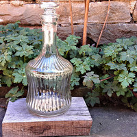 Vintage glass decanter with round stopper
