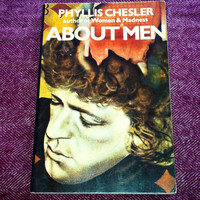 About Men by Phyllis Chesler. Feminist book with adorable handmade feminist bracelet. Secondhand feminist book.