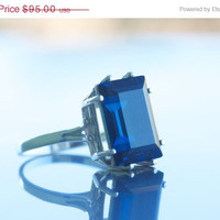 LOVE ON SALE Sterling silver ring with a 14x10mm Swarovski step-cut crystal in Montana Blue