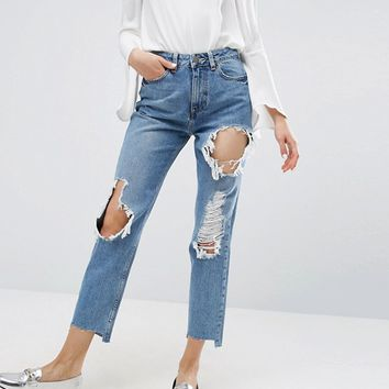 ASOS ORIGINAL MOM Jeans in Phoebe Mid Stonewash with Busts and Stepped Hem at asos.com