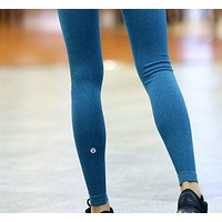 LULULEMON pure color all-around all-around running yoga workout pants with long legs and a seamless nine-point leg.BLUE