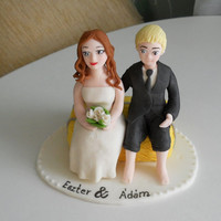 Honeymoon couple sitting on straw bales fondant wedding cake topper